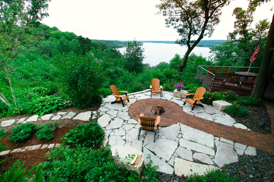 stone work patio with brick firepit lakeside