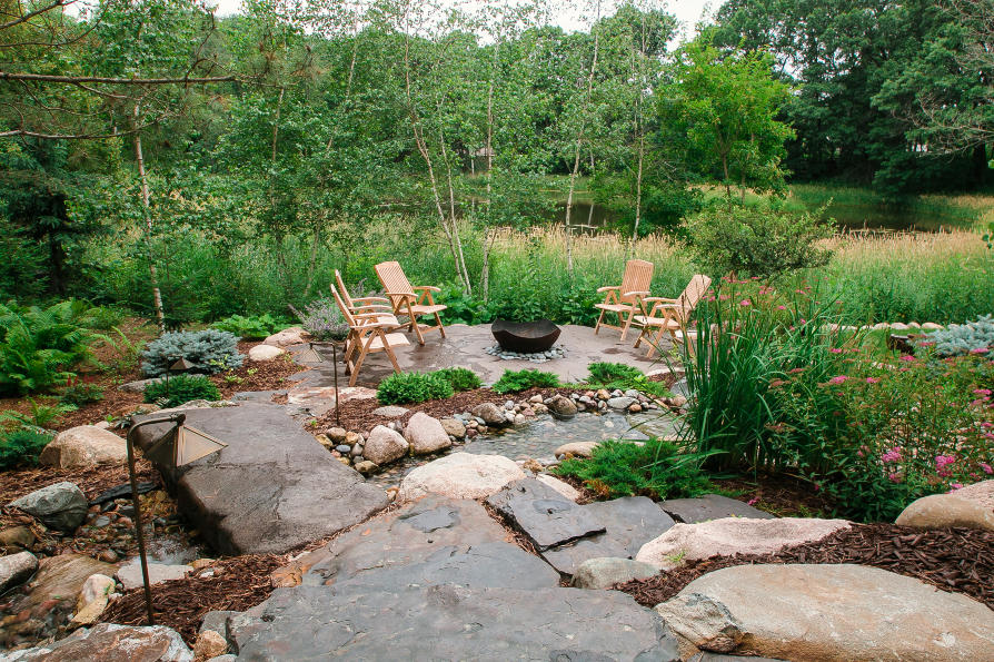 stone patio with water fall feature